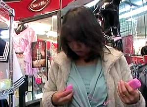 japanese couple play with toys in sex shop and outside 02.jpg