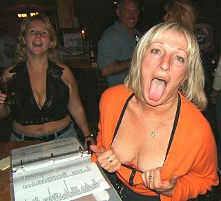 Amateur mature women show cleavage_ one sticks out tongue.jpg