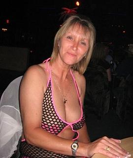Big breasted mature blonde woman in sexy fishnet outfit.JPG