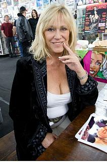 Blonde mature woman in her fifties shows cleavage.JPG